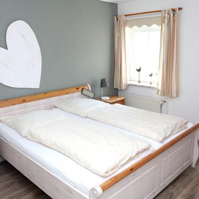 Schlafzimmer in der Ferienwohnung Achtern Diek